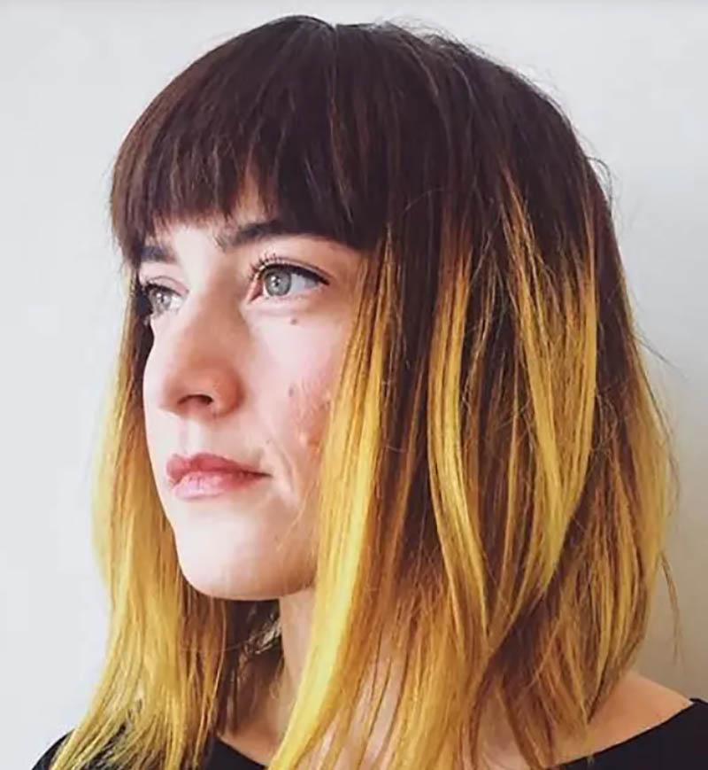 Tóc nhuộm Ombre màu vàng sáng với mái bằng